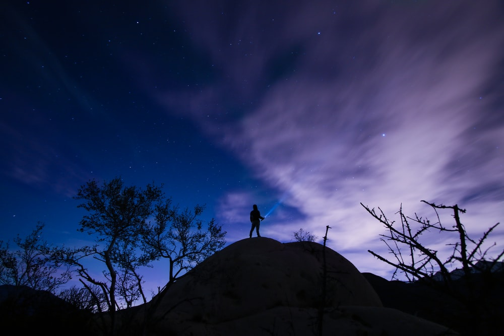 silhouette of a person on mountain hill