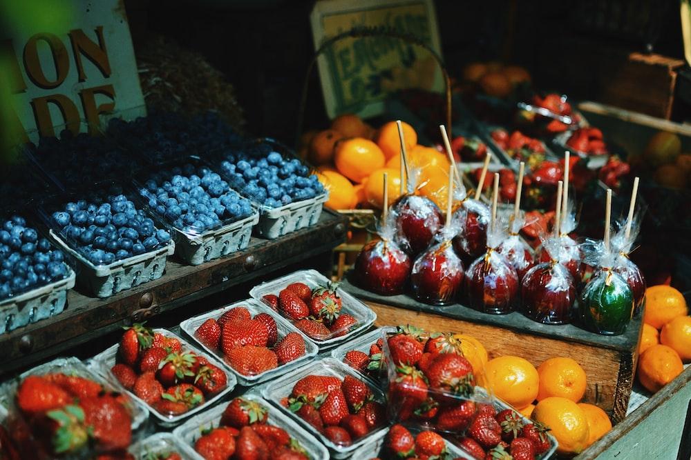 Assorted fresh fruit at an outdoor farmer's market