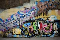 photo of white, pink, and blue graffiti