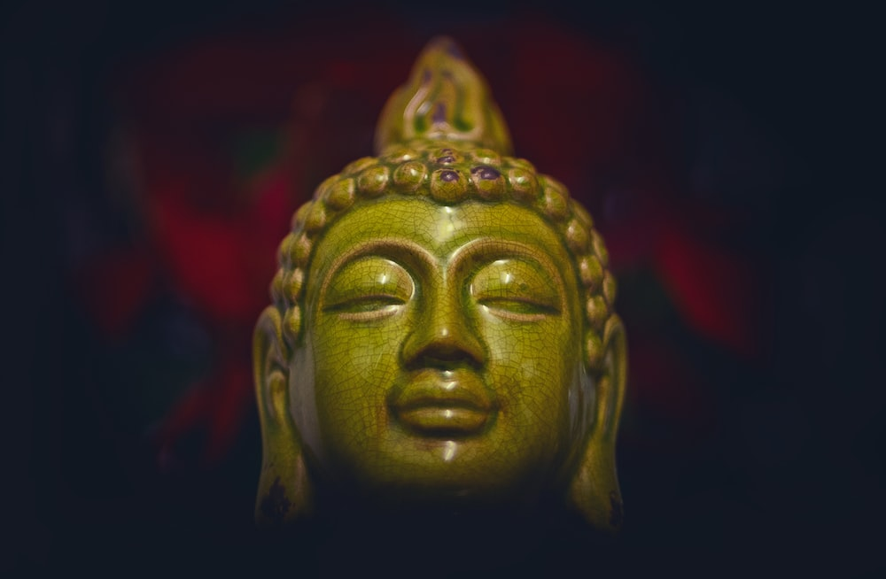 green ceramic buddha head
