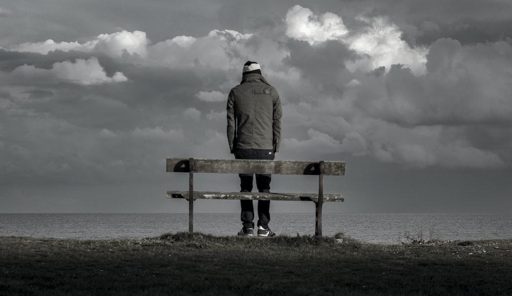 man standing near bench