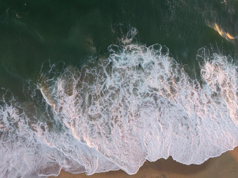 sea waves crashing on seashore