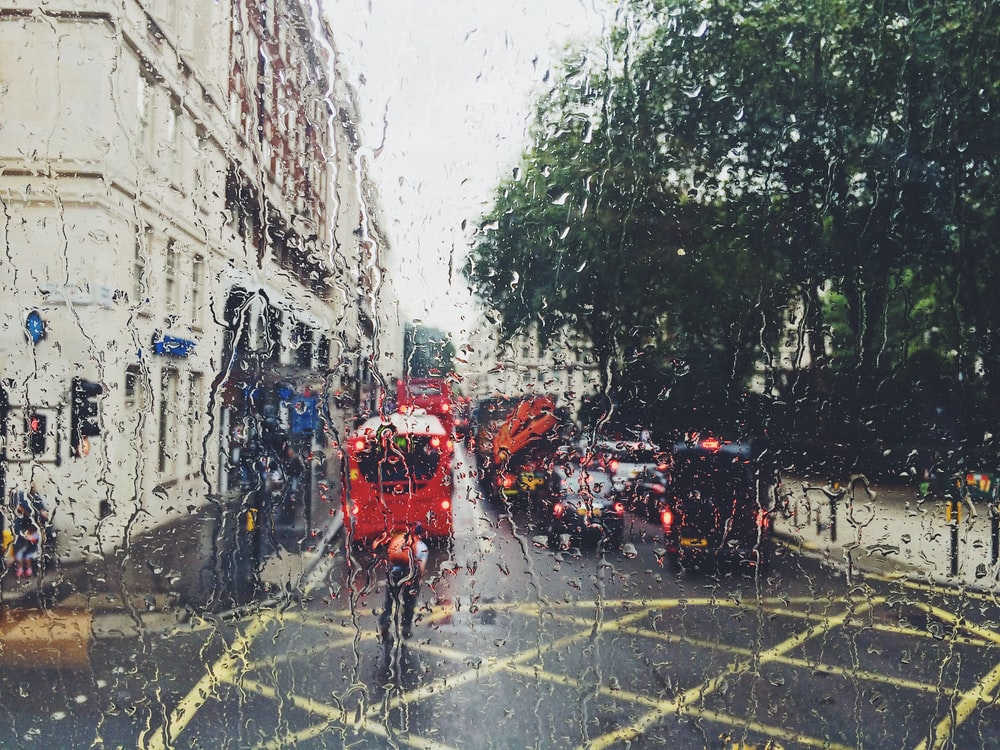 photo of red bus on street from window