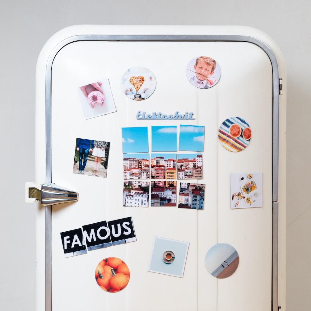 assorted-type photos stick on white single-door refrigerator