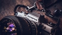 shallow focus photo of Olympus camera