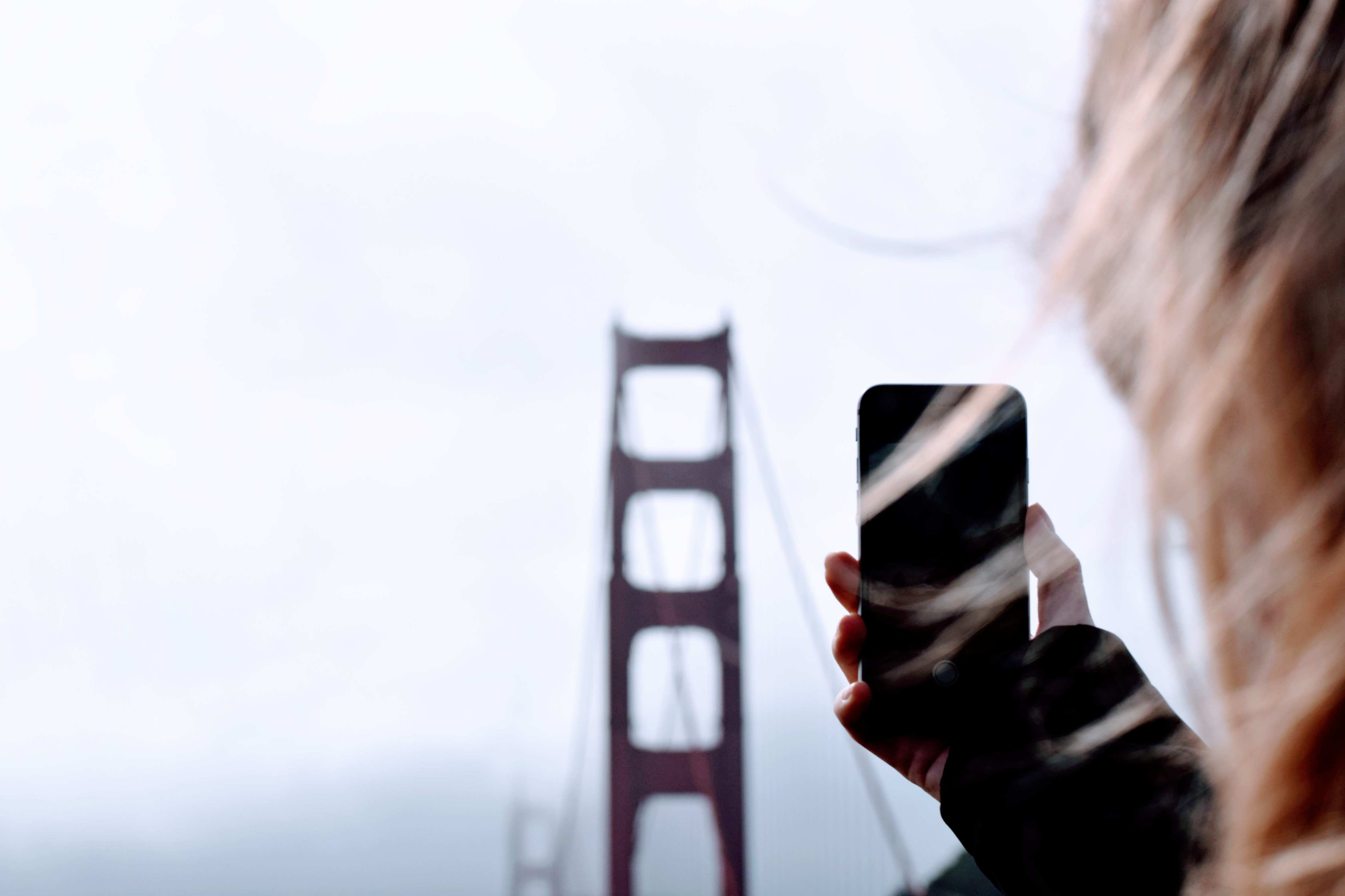 person taking a photo of Golden Gate bridge