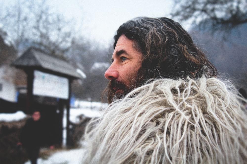 man wearing beige parka coat
