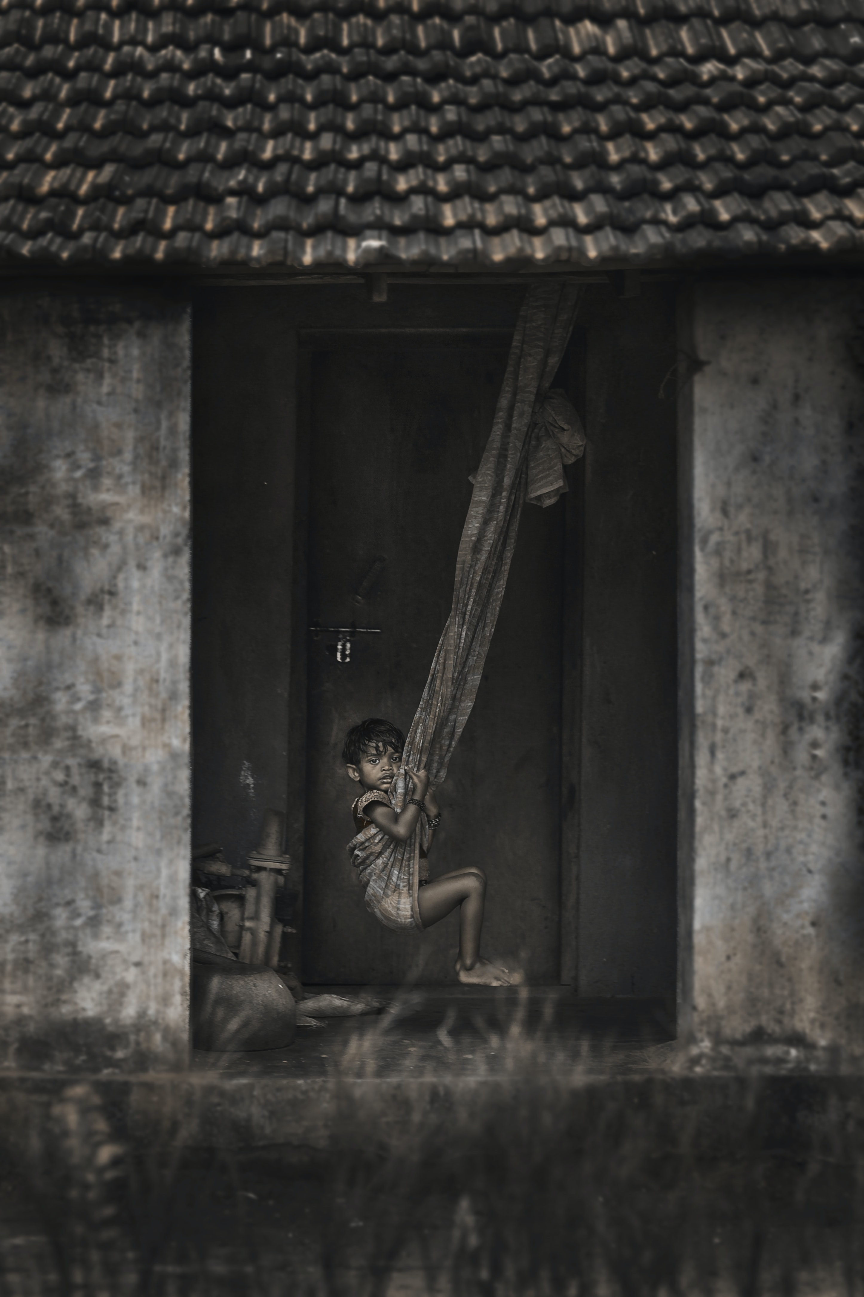 grayscale photo of girl riding hammock