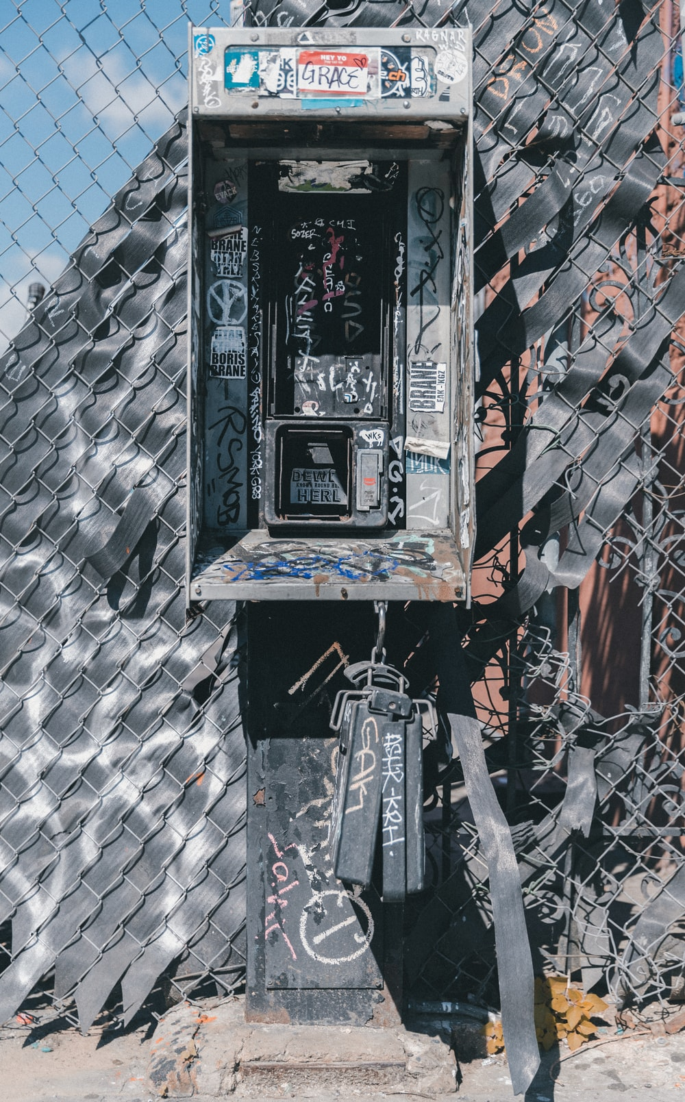 gray and black telephone booth