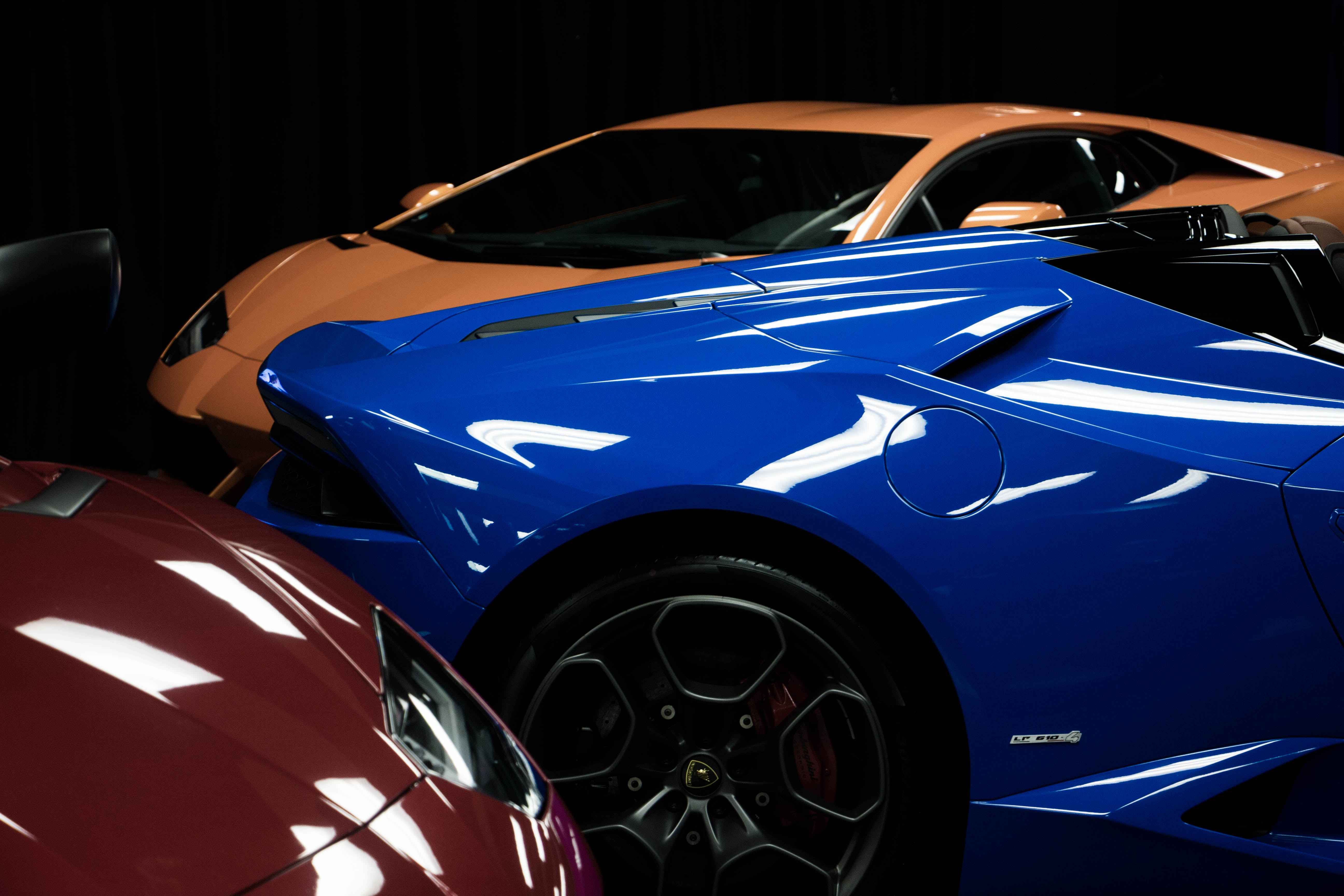 Red, orange and blue race cars.