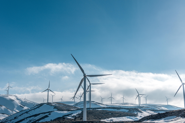 A wind farm on snowy hills in Greece