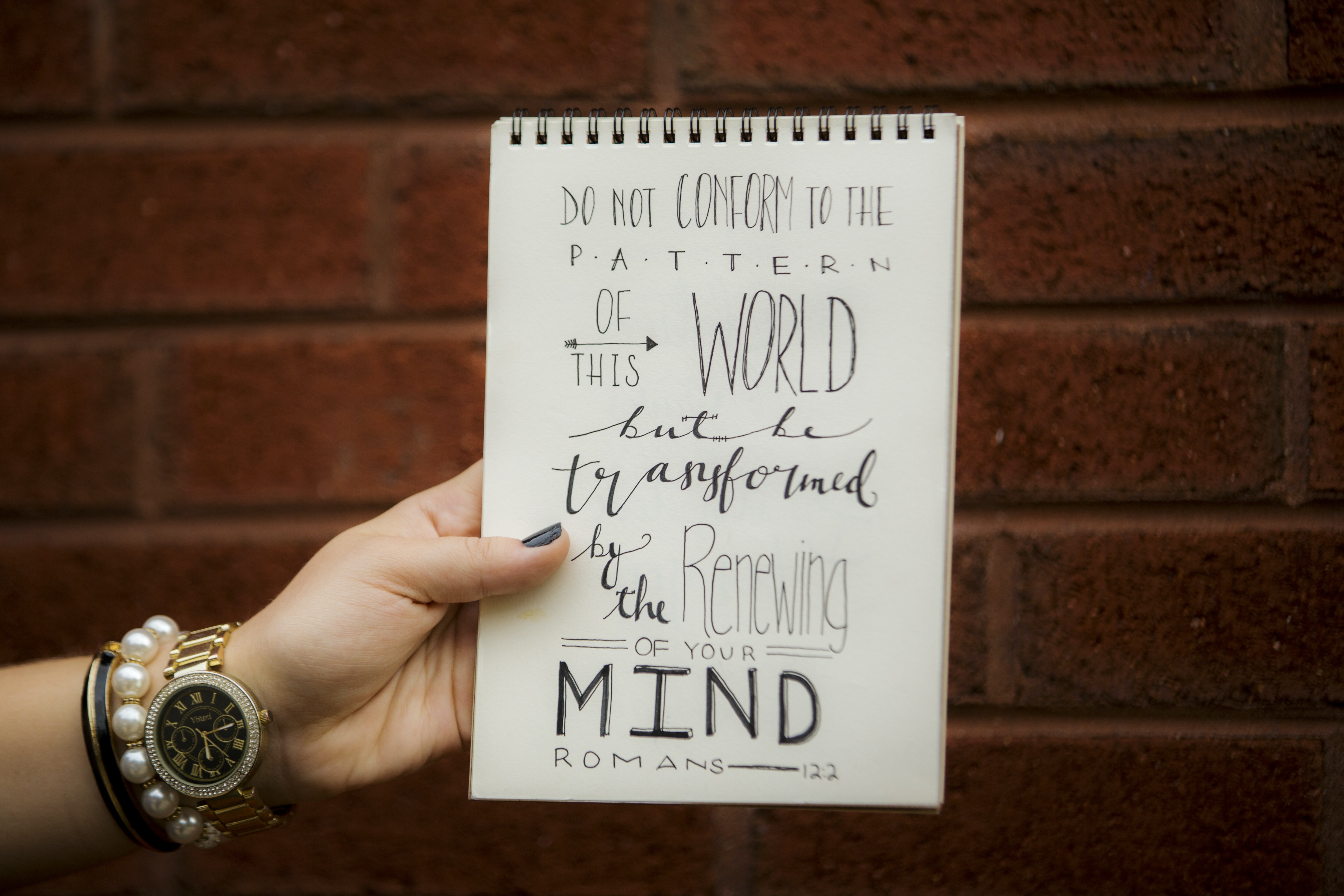"A piece of paper that reads ""Do not conform to the pattern of this world but be transformed by the renewing of your mind."""