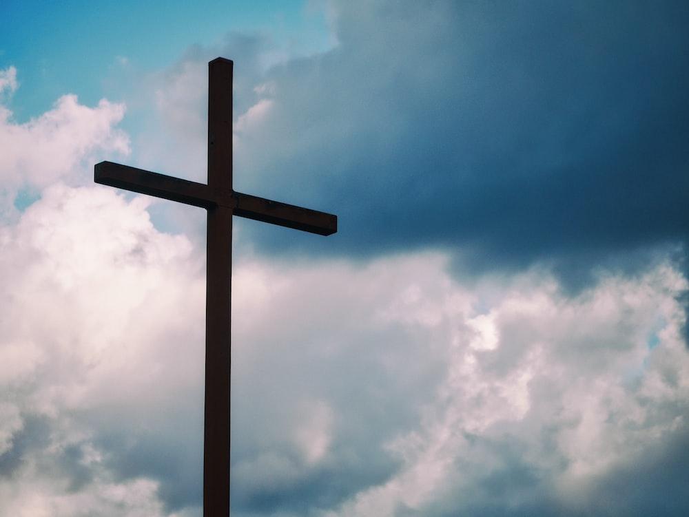 black cross under blue sky