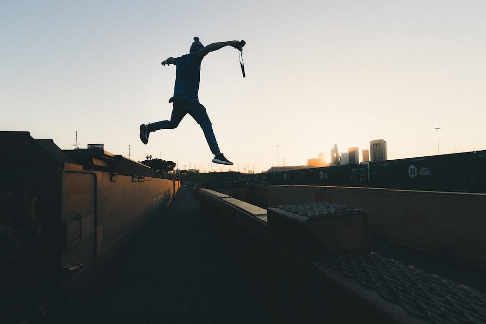 person jump through building