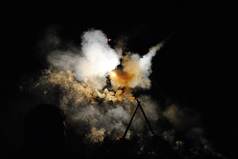 white smoke during night time