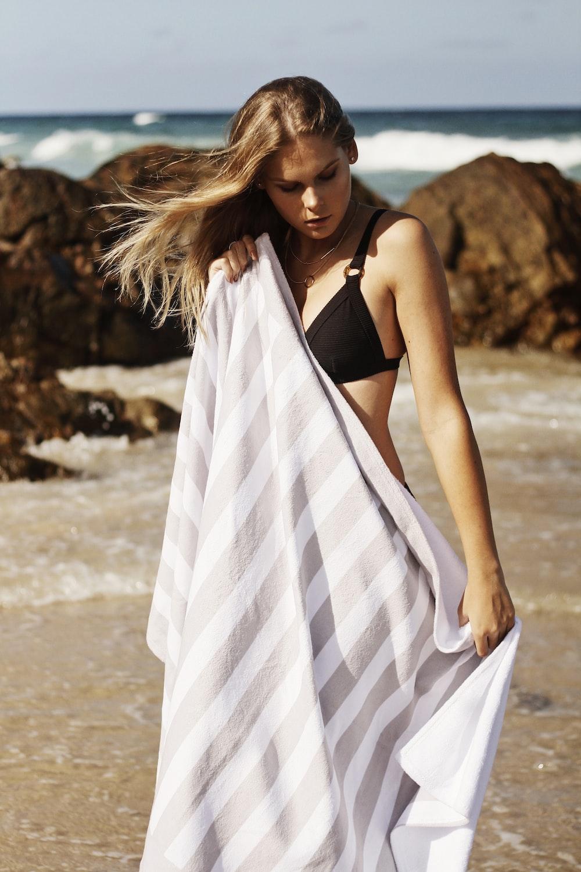 woman wearing bikini covering body with white cloth