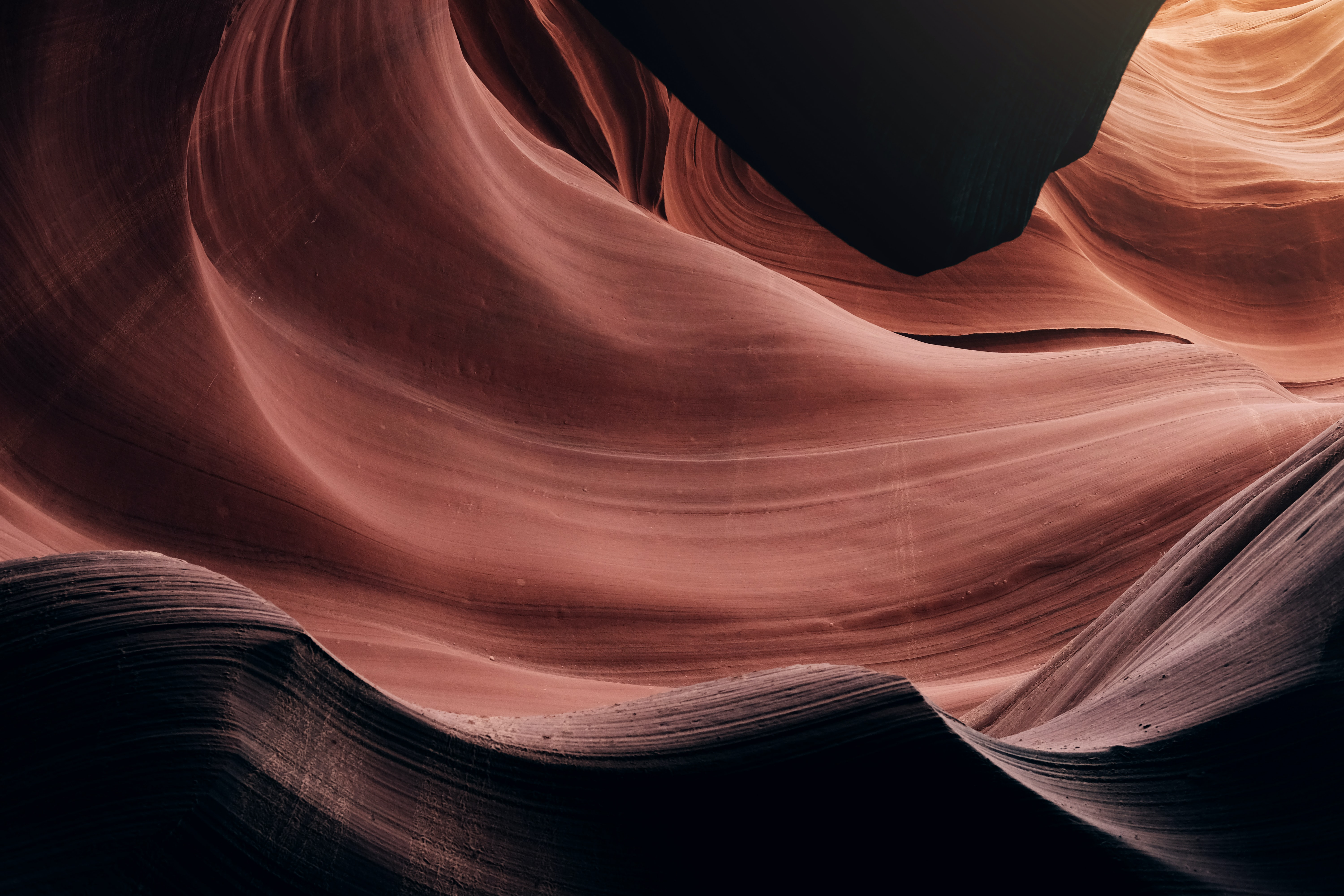 Layers of orange textured sandstone form patterns in Antelope Canyon