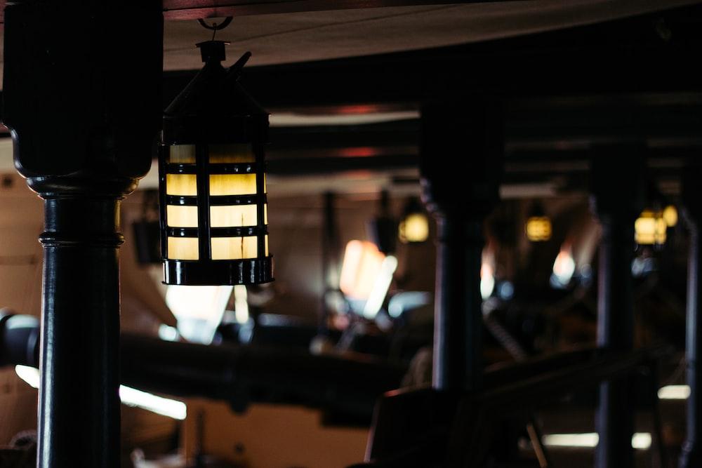 closeup photo of turned-on pendant lamp
