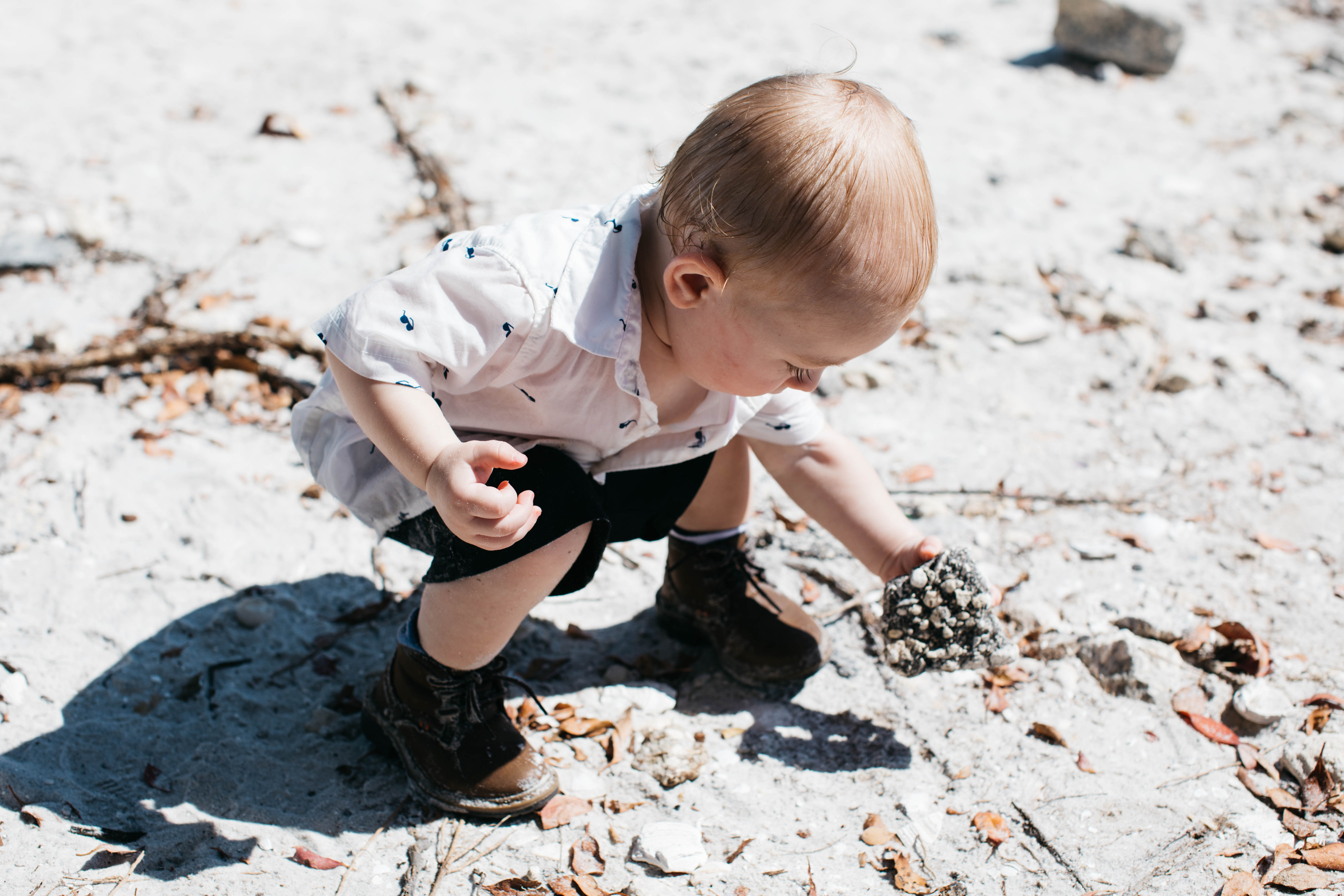 A boy playing in the sand.