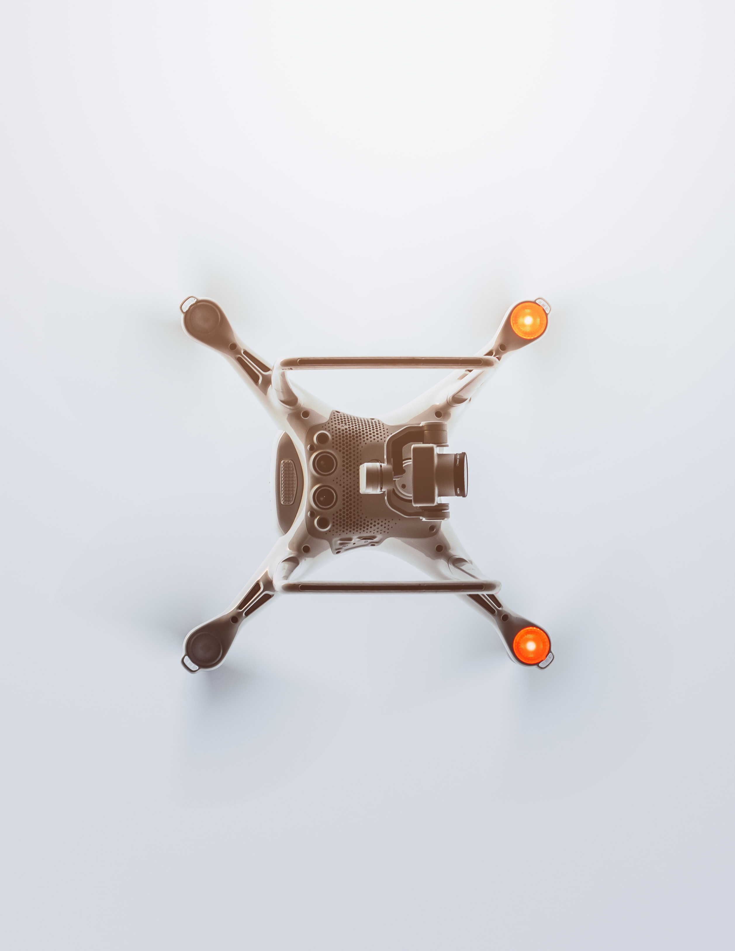 A DJI Phantom drone on a white surface