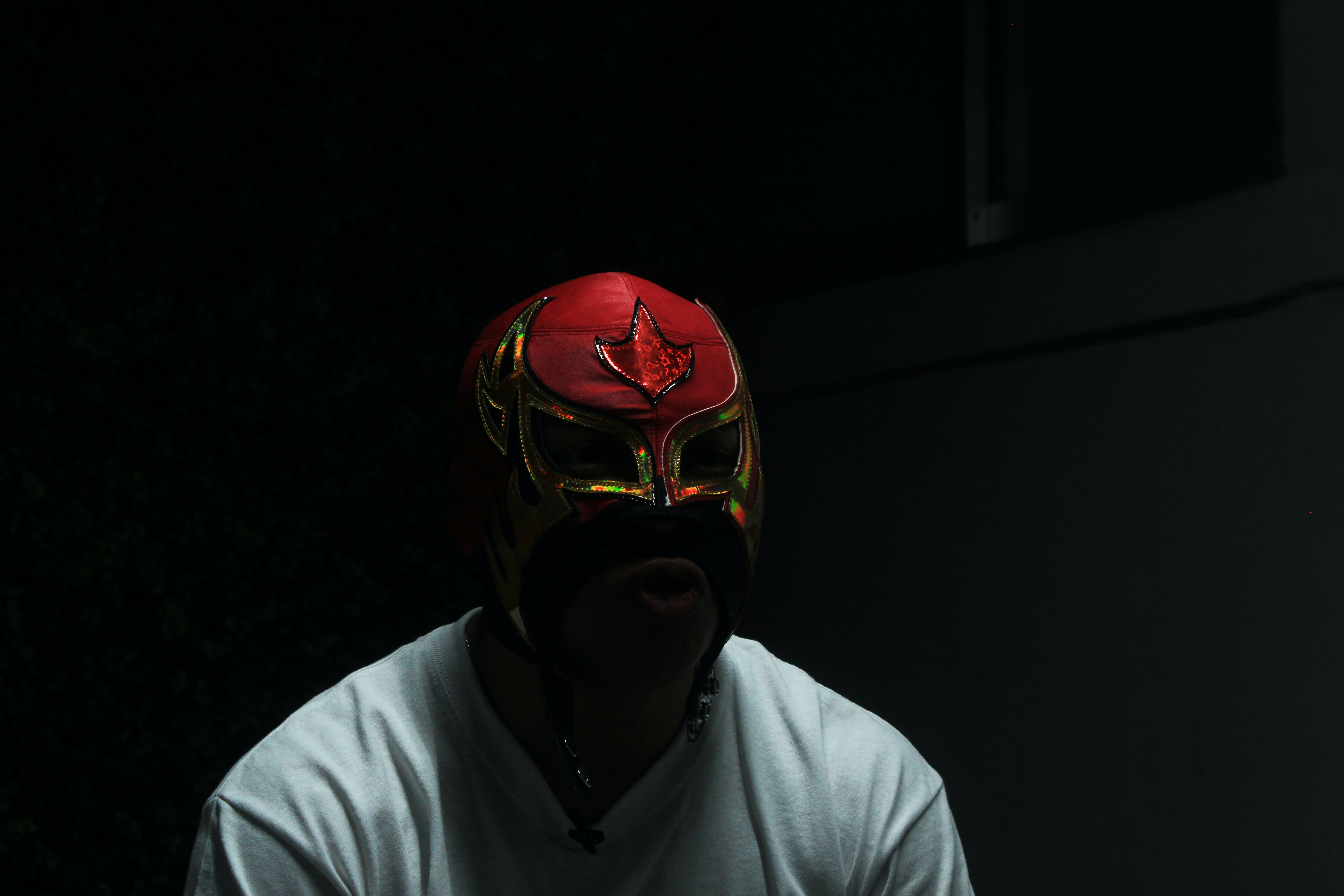 man wearing red mask and white shirt