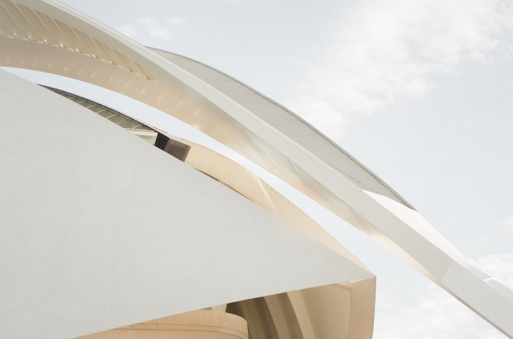A long arch at the edge of a modern white facade