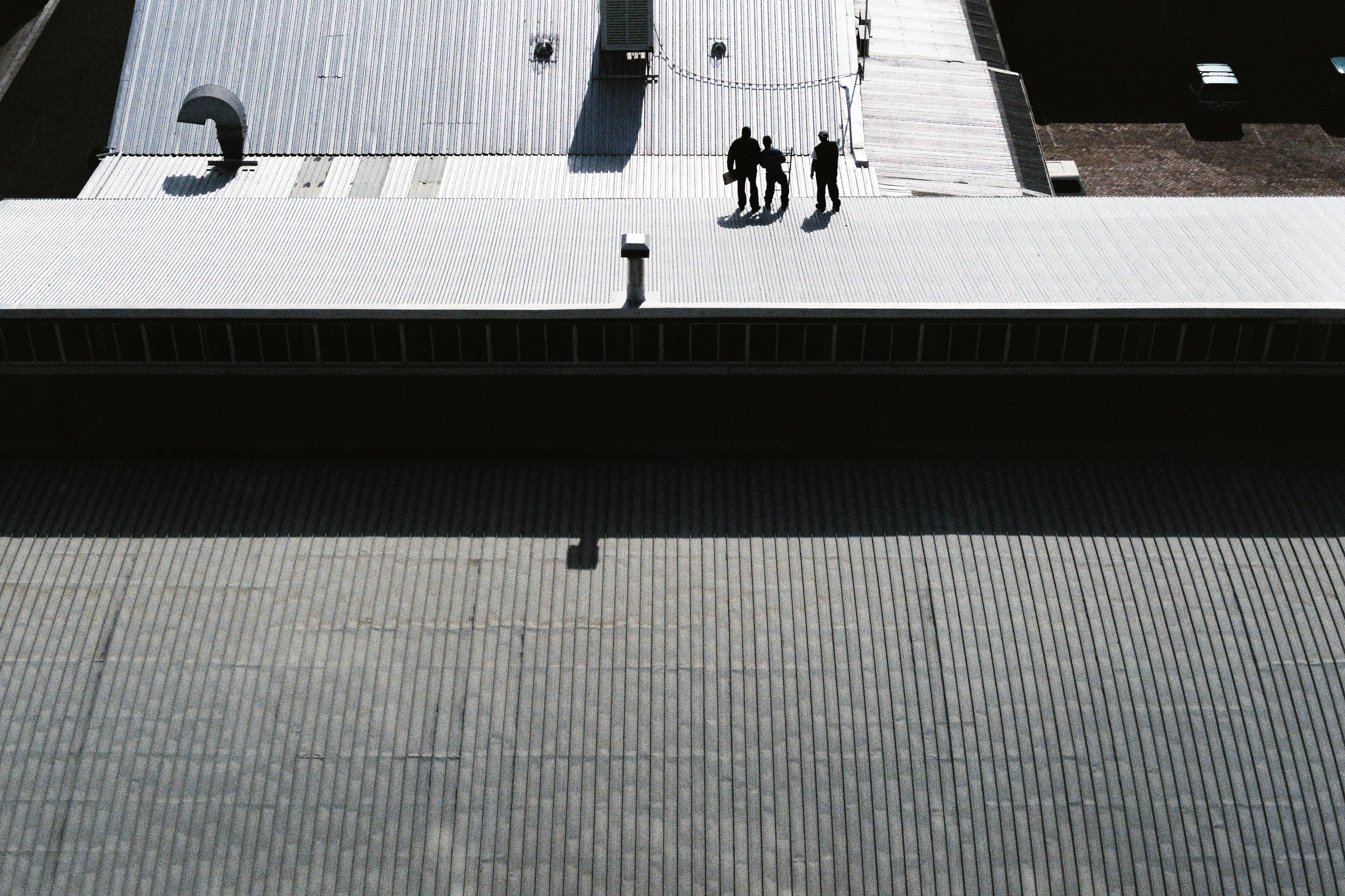 Shadows of men working on rooftop in Woodstock