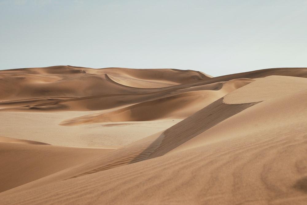 desert under clear blue sky during daytime