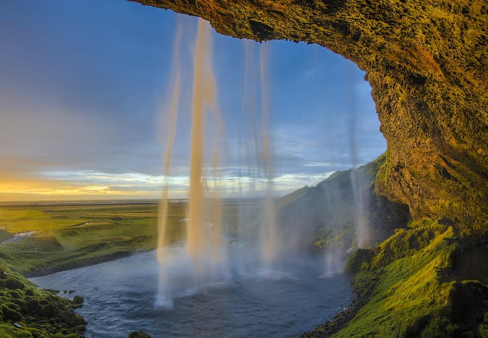 waterfalls under blue skies