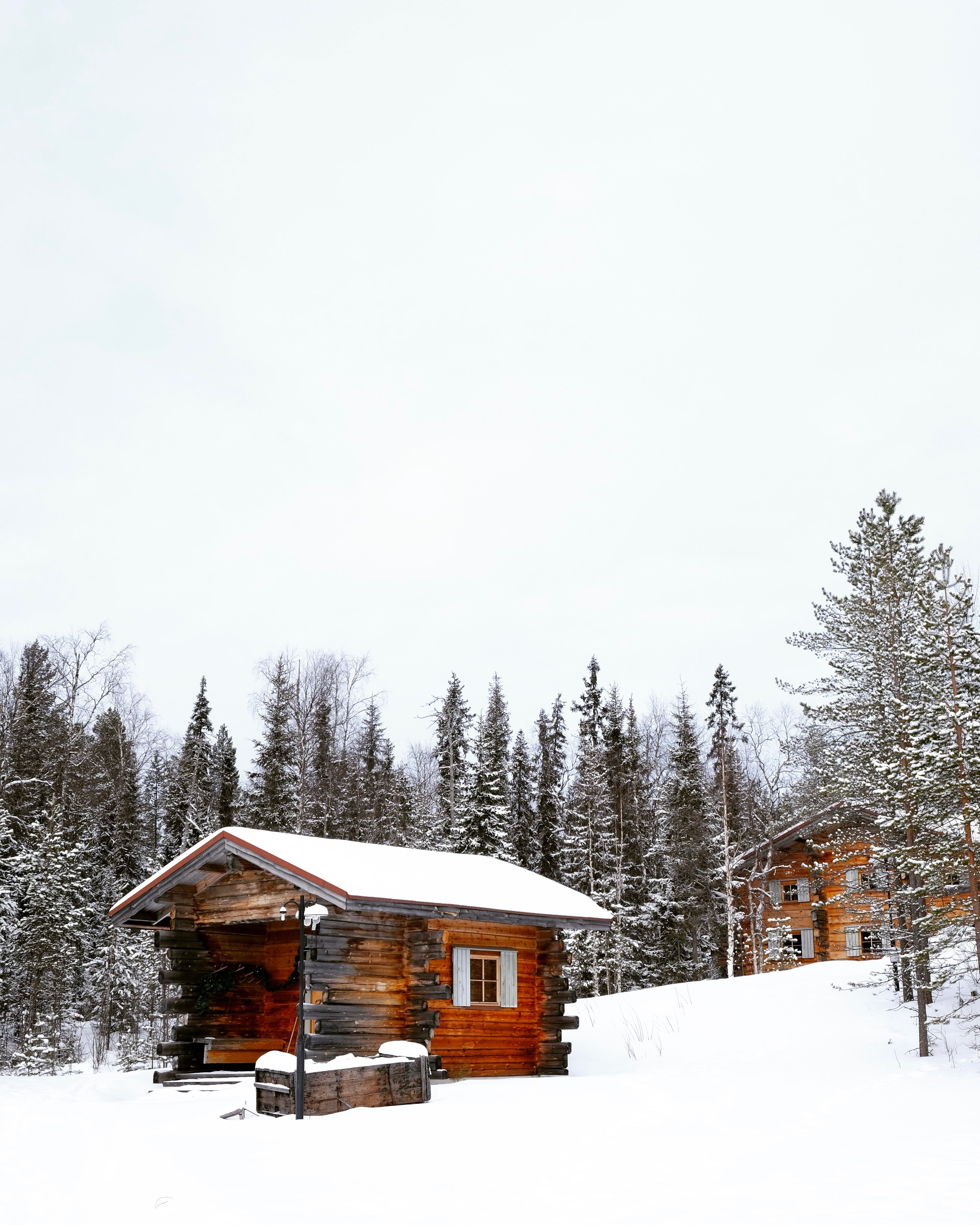 A wooden cabin sitting on a mountain in Rovaniemi, Finland