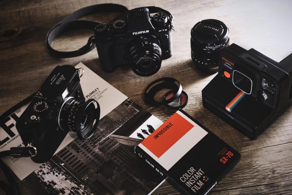 black box surround by three cameras