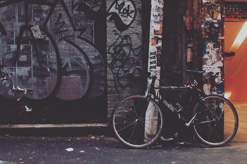 black bicycle near post