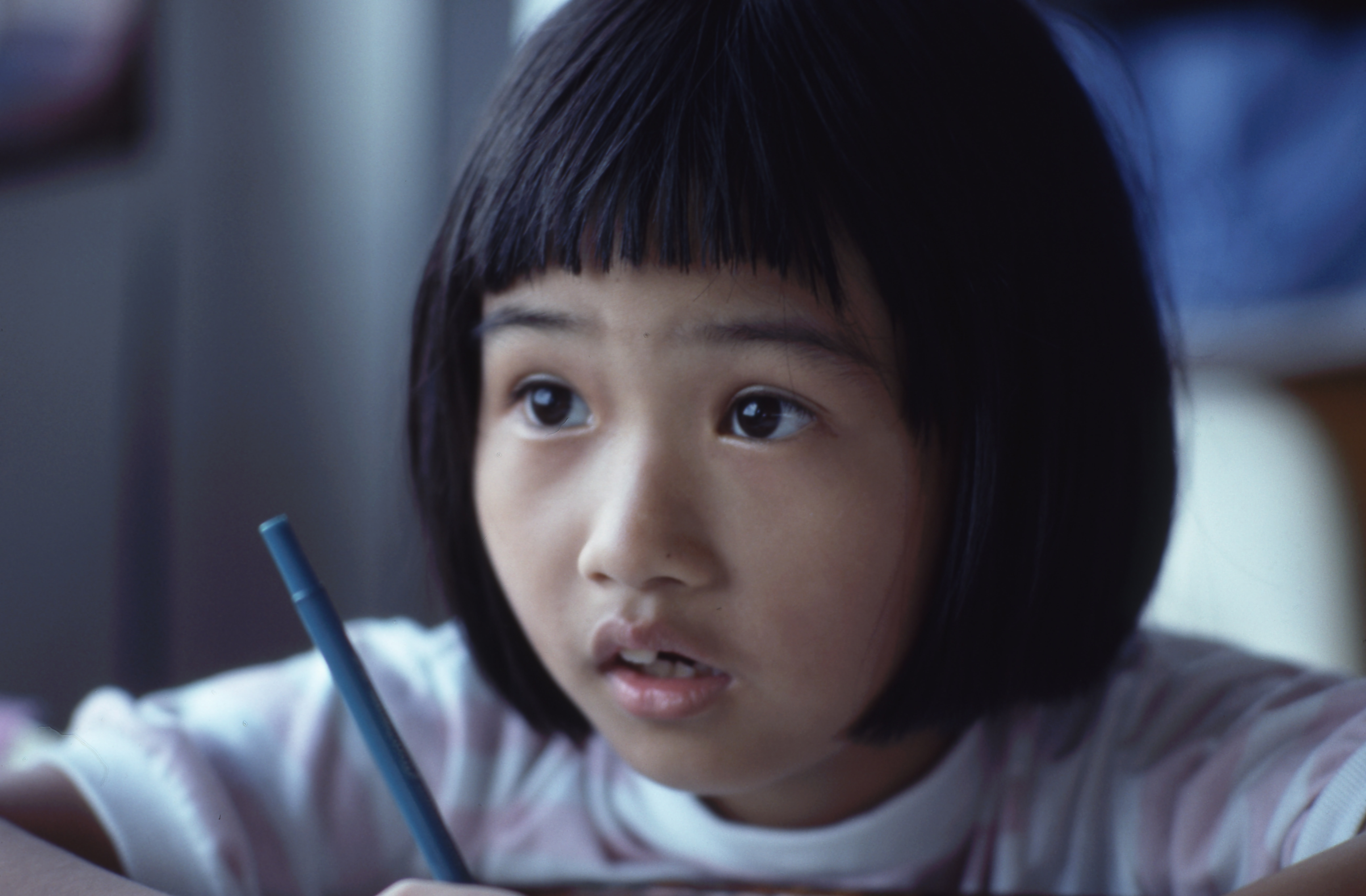 A child concentrating hard at school