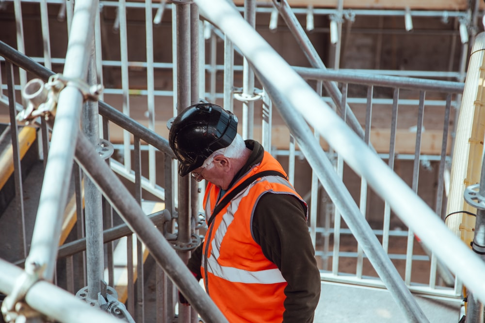 man standing under scaffoldings