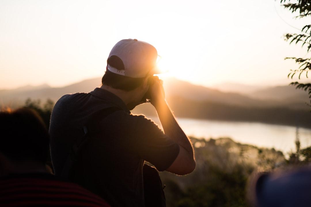 Photographer taking a sunset shot