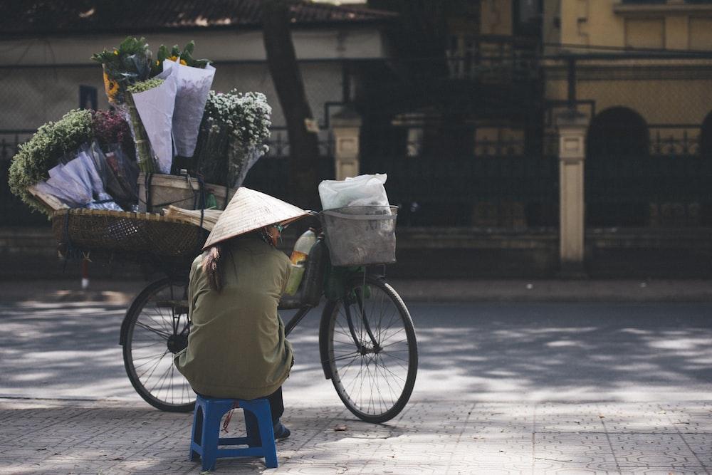 woman sitting beside the mountain bike