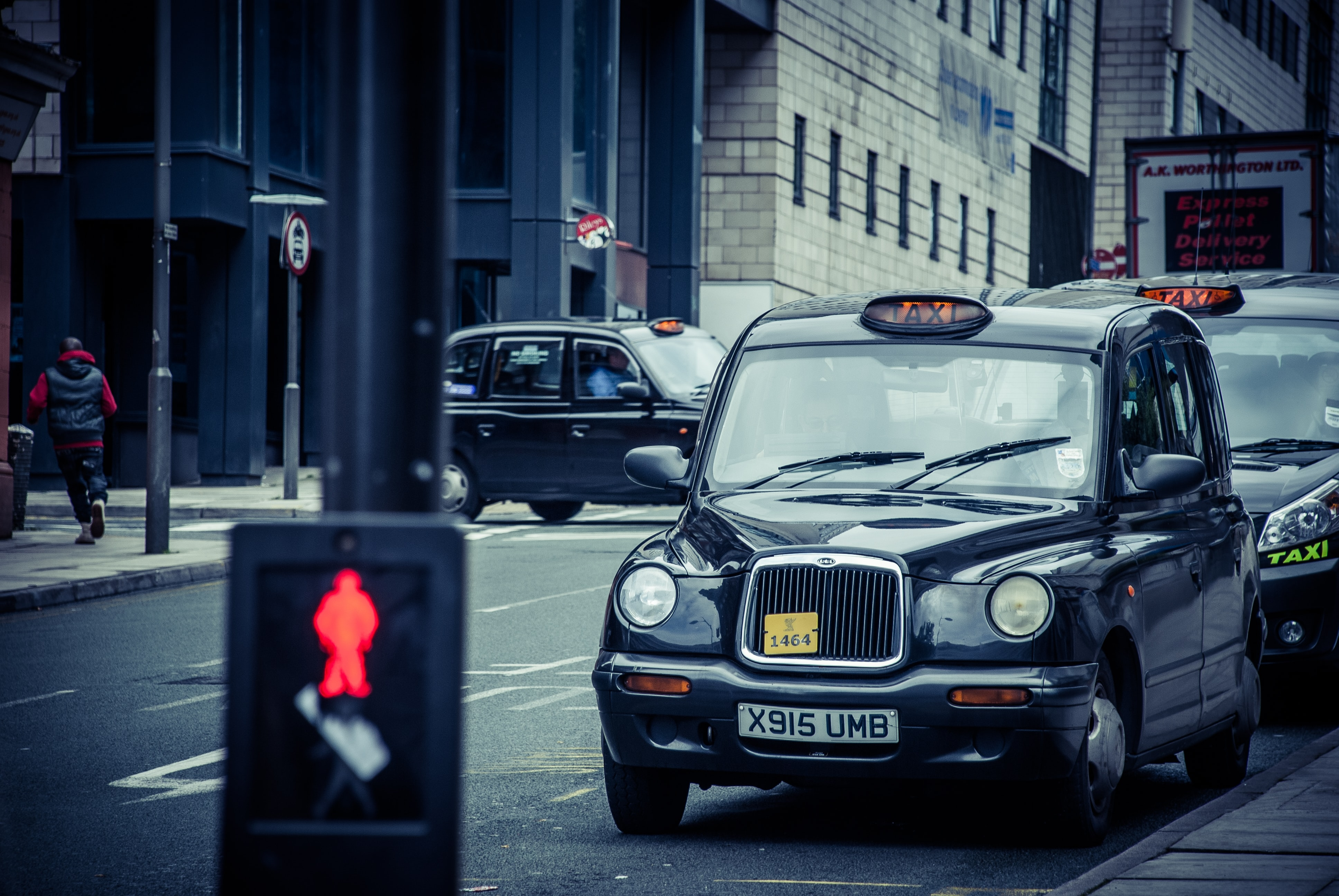 English taxis parked along the road in Liverpool