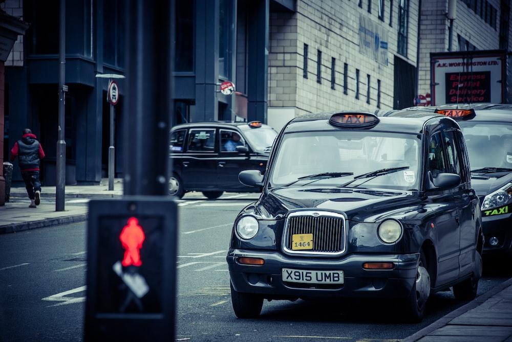 black 5-door hatchback on road