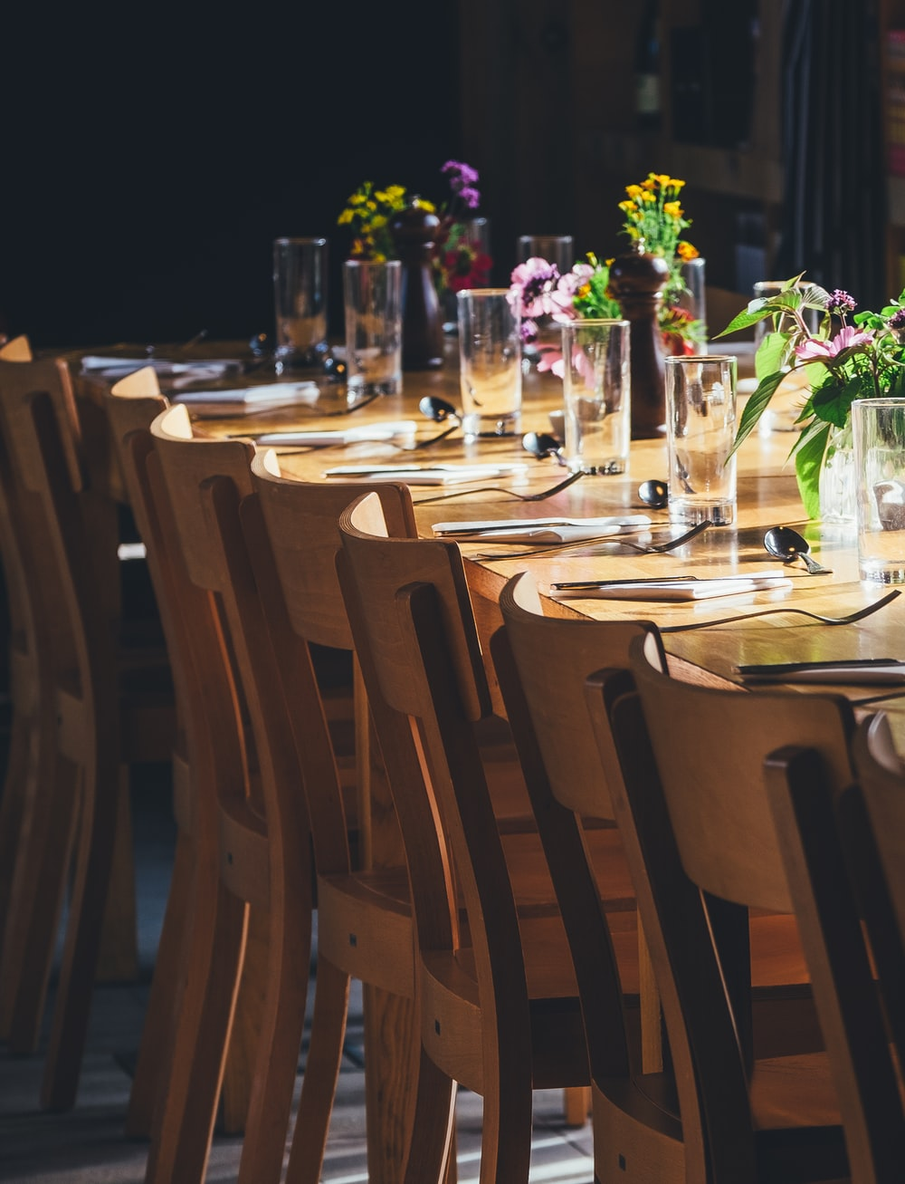dining table with drinking high glass and fork