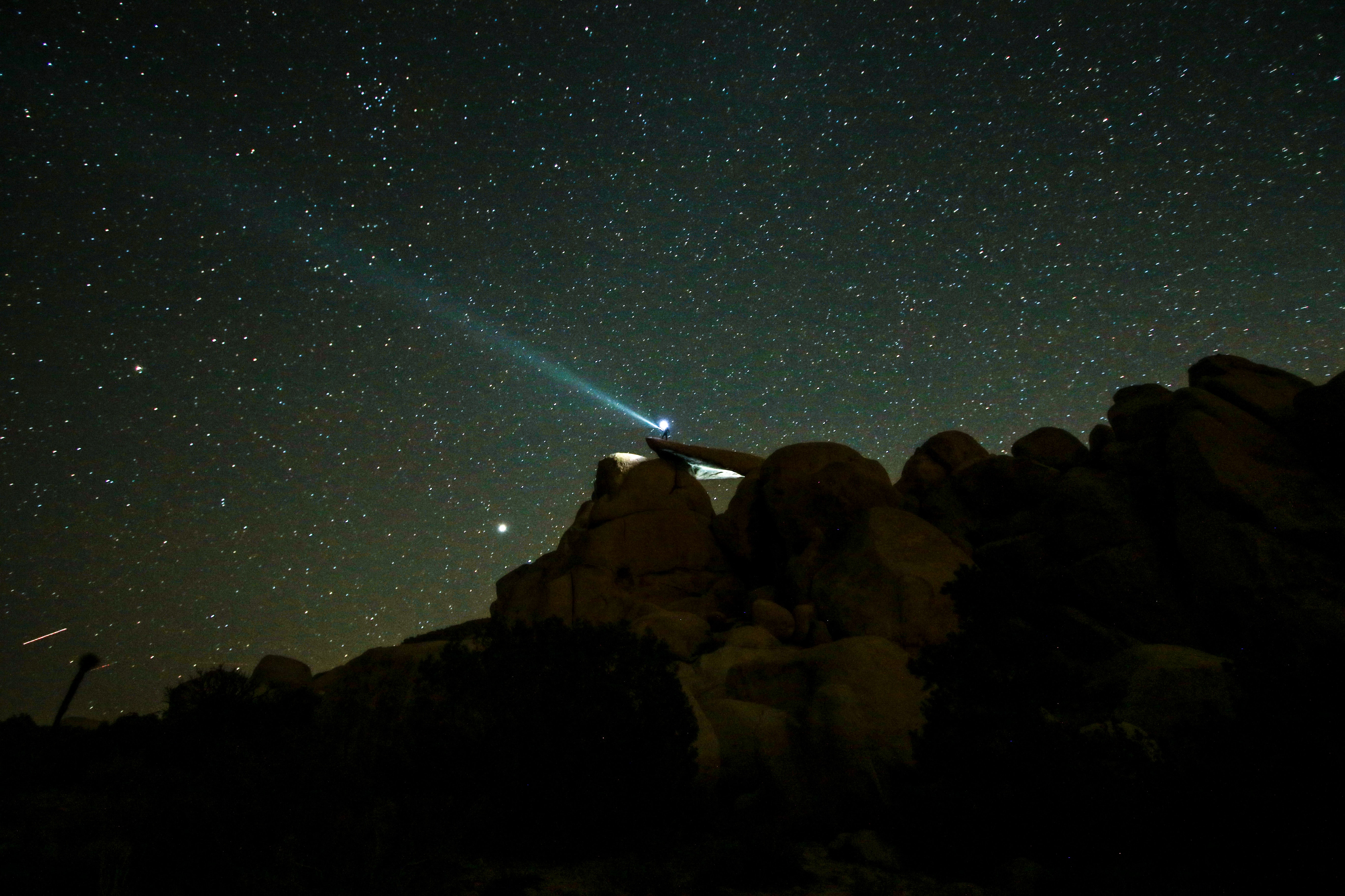 rock formations under starry night