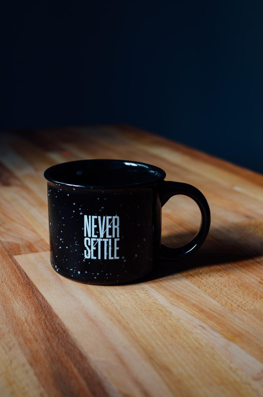 black ceramic mug on table