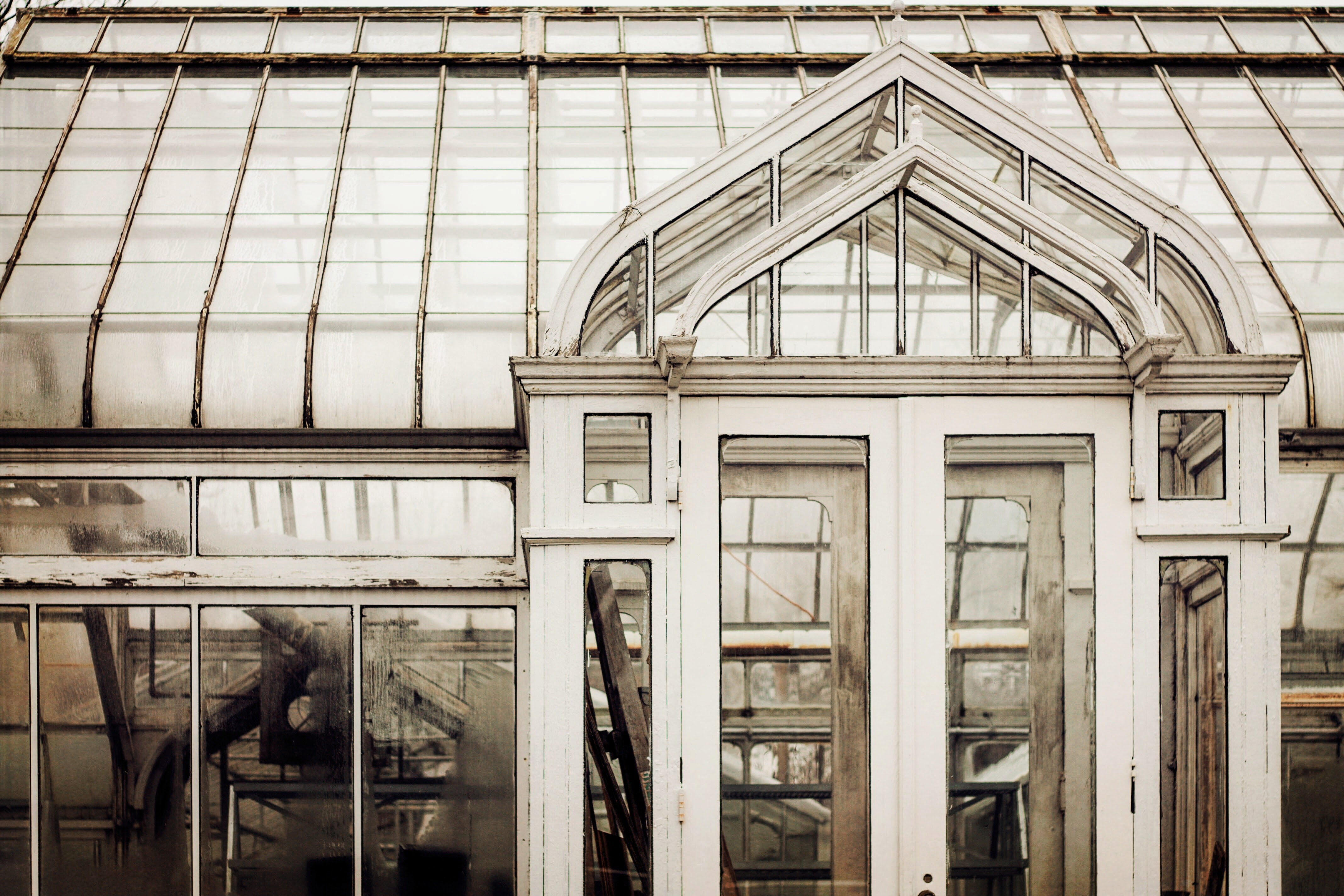 A modern glass greenhouse building full of glass windows in Holland.