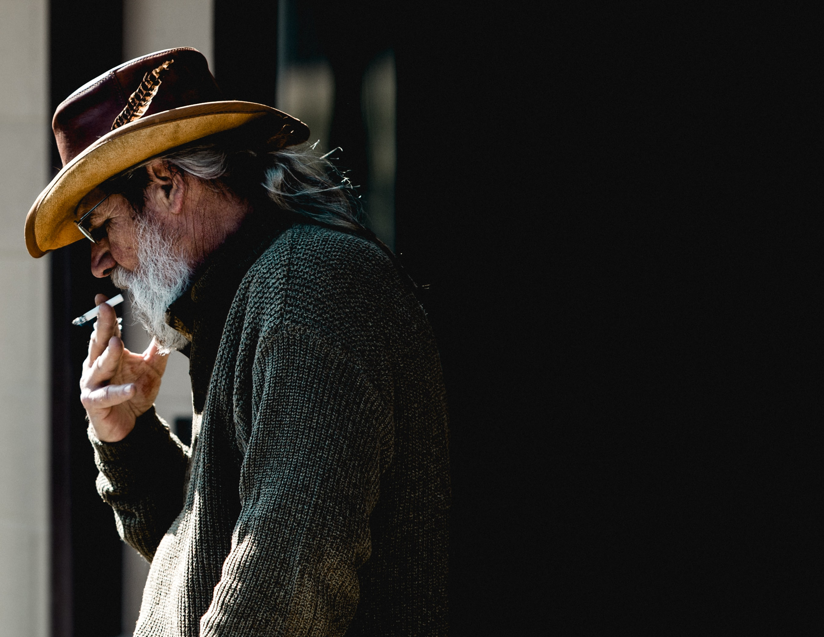man standing while smoking cigarette