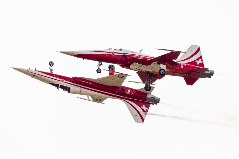 red and white fighting plane
