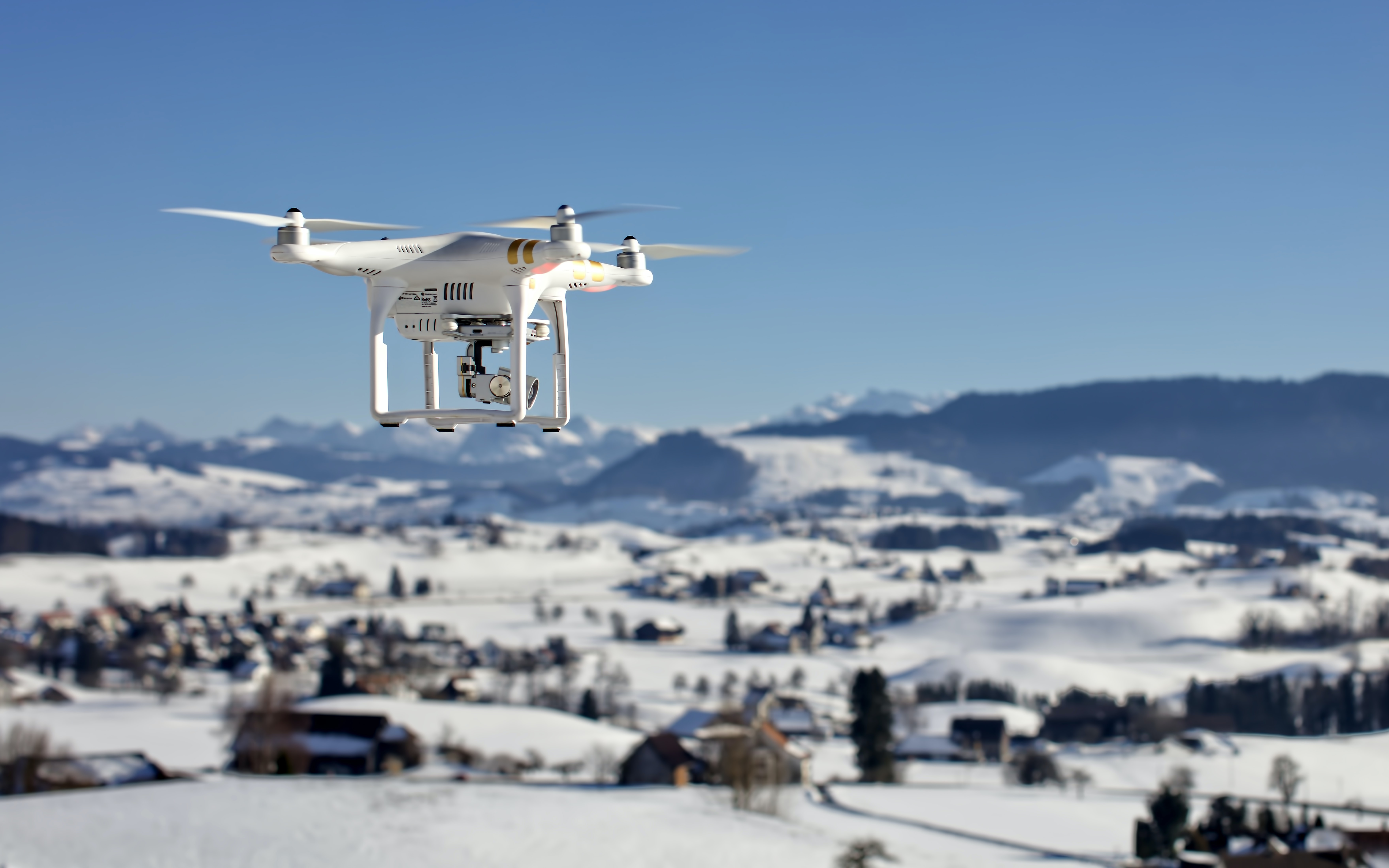 drone over snow covered houses