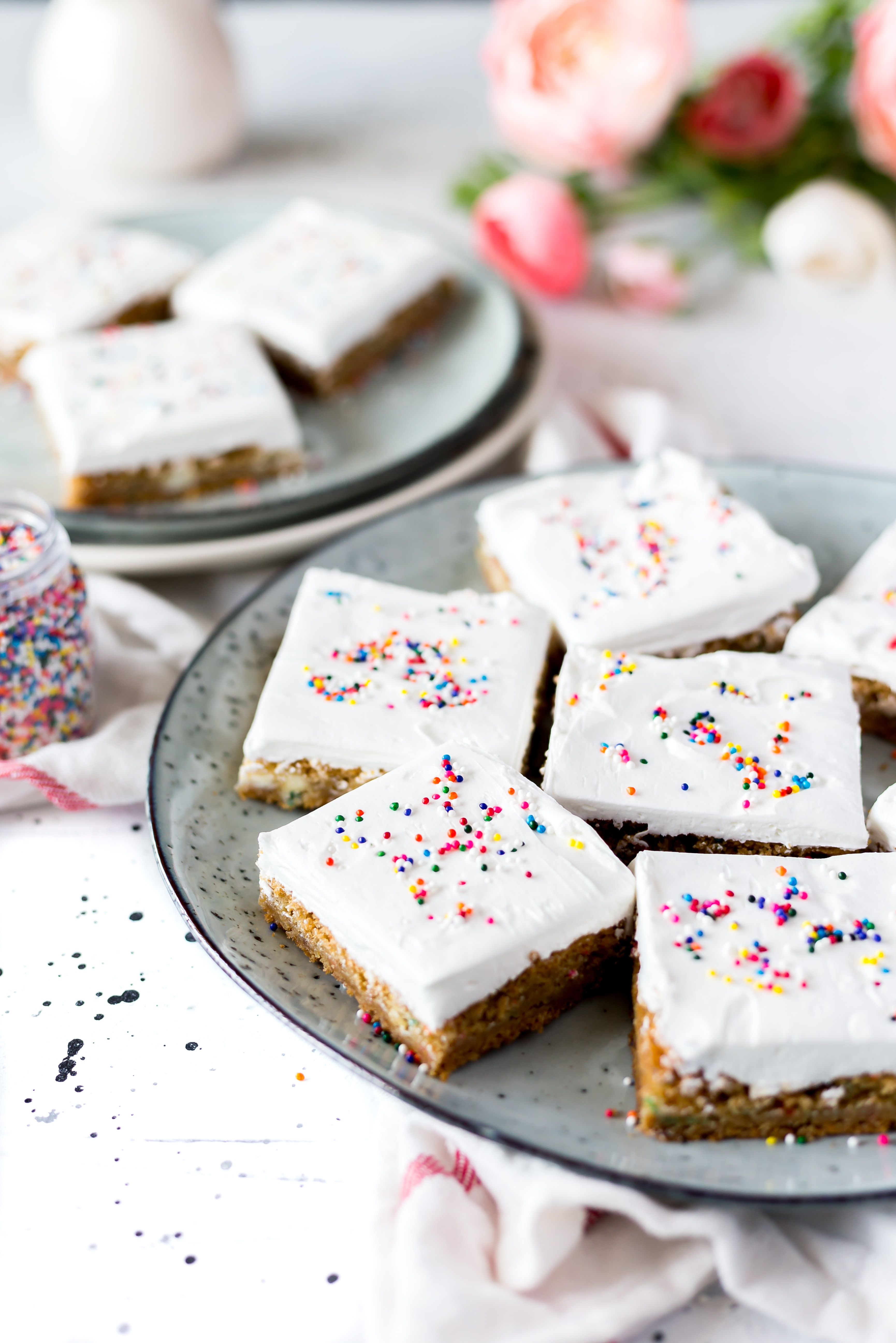 white cakes with sprinkles