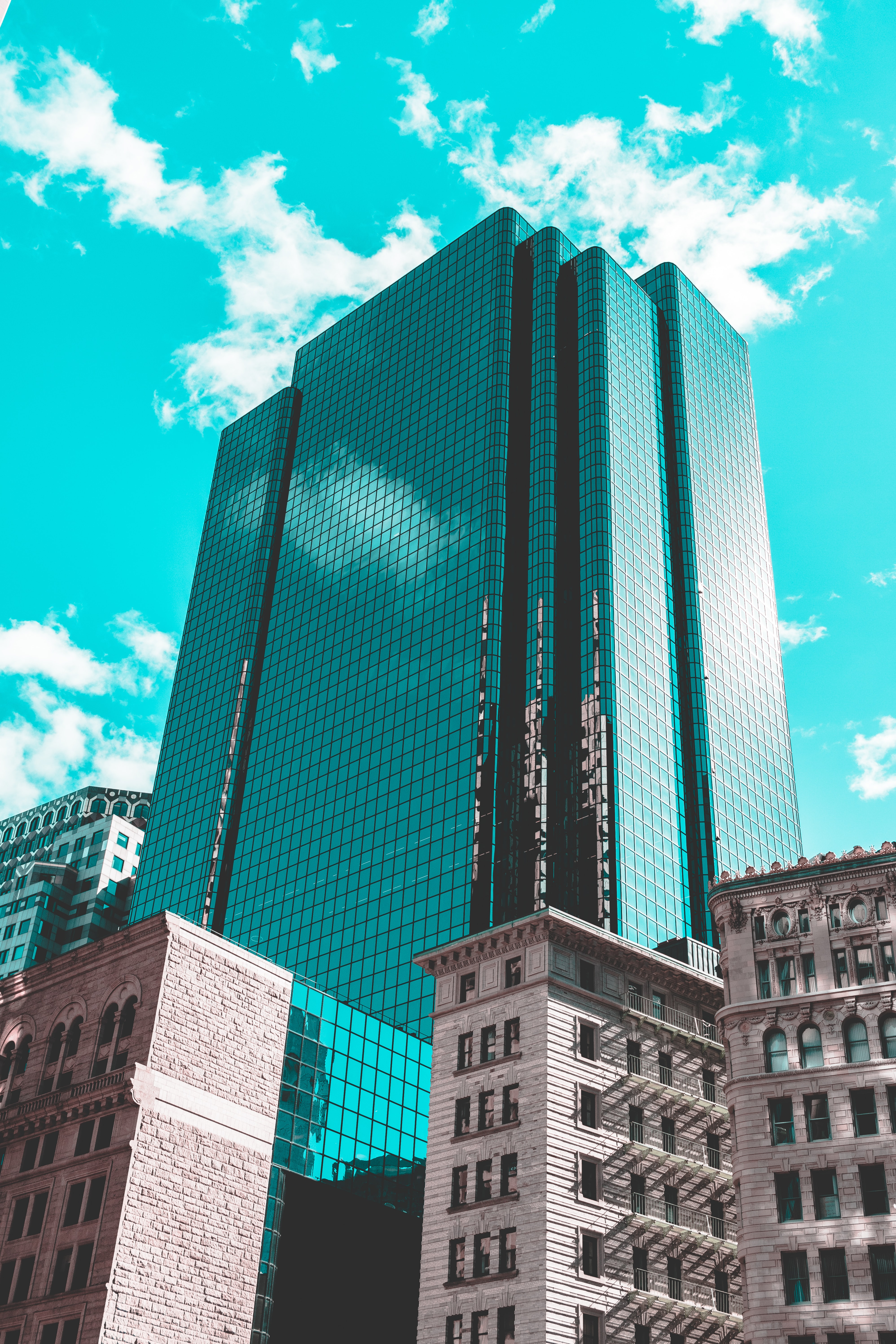 Turquoise sky frames a reflective downtown office building