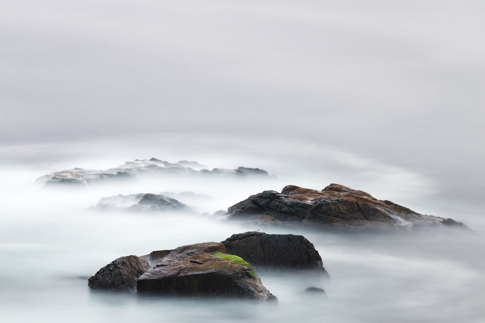 time lapse photography of water near island