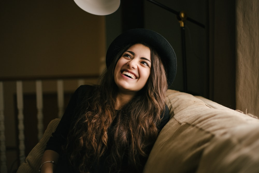 woman wearing black hat