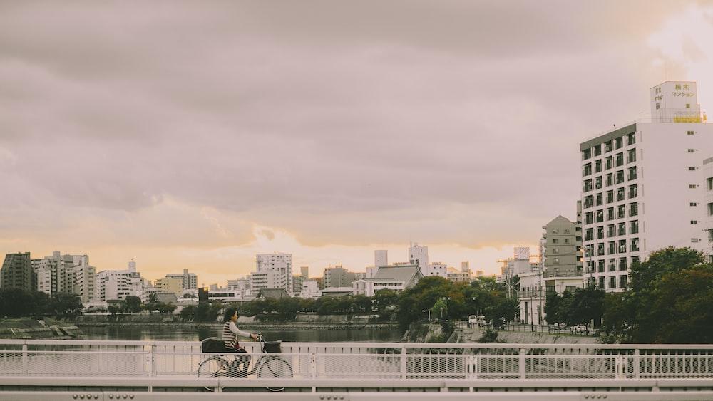 person riding bike on bridge